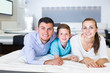 young family of three choosing right mattress in home furnishings store