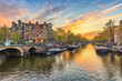 canvas print picture - Amsterdam sunset city skyline at canal waterfront, Amsterdam, Netherlands