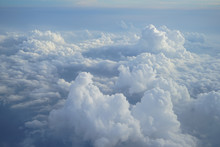 View Of Beautiful Heaven Cloudscape With Shades Of Blue Sky Background From Flying Plane Window