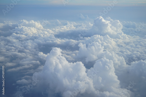 Obraz View of beautiful heaven cloudscape with shades of blue sky background from flying plane window - fototapety do salonu