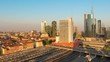 timelapse of milan city at sunset zoom out aerial view