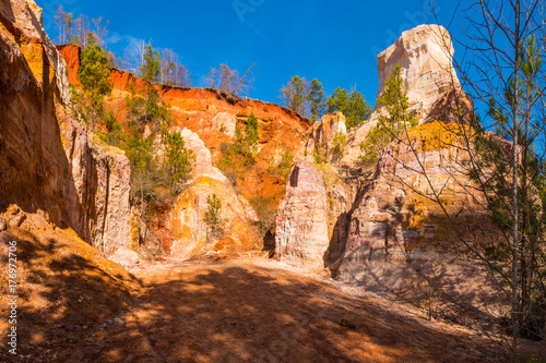 Tuinposter Canyon Red loamy floor and wall of Providence Canyon in sunny autumn day, USA