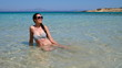 Europe's Secret Islands/ Woman sitting in the water in the sea.