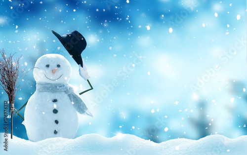 Foto op Canvas Lichtblauw New year greeting card with copy-space.Happy snowman standing in christmas landscape.Snow background