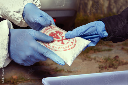 Photo  Police staff stock to container drugs found in car under the bridge