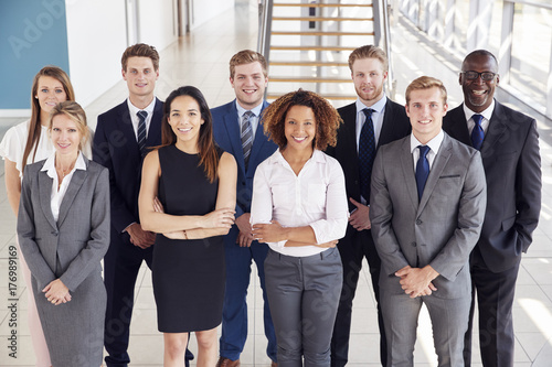 Fototapety, obrazy: Office workers in a modern lobby, group portrait
