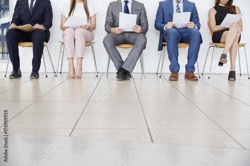 Fotografia  Five candidates waiting for job interviews, front view, crop