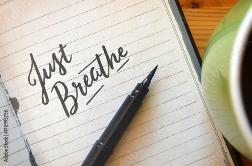 Fotografie, Obraz  JUST BREATHE brush calligraphy in notebook with cup of coffee on desk