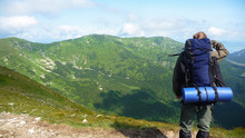 Man Standing In Mountains With...