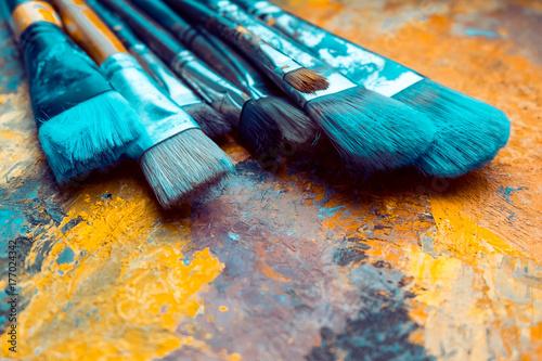 Artist Paint brushes on canvas Fototapet