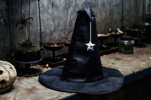 Witch Hat On Wooden Table. Halloween Holiday Concept.
