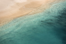Aerial View Of The Tidal Waves Reaching The Empty Sandy Beach On Bali