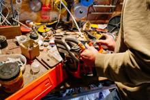 Man Repairing A Chainsaw In Th...