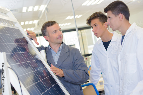 Students being showed a solar panel