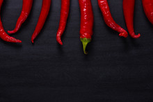 Chili.Red Chili Peppers On Bla...