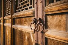 The Knocker On The Wooden Door