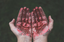 Hands Covered By Red Glitters
