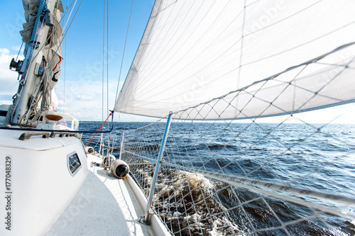 Poster Zeilen Sailing fast on port tacks with water splashing on deck