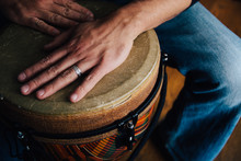 Hands Of A Man Playing A Djembe Drum