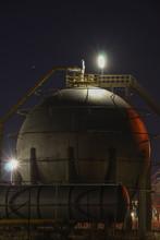 Oil Refinery Tank At Night