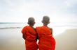 Buddhist monks at the beach. Sri Lanka.