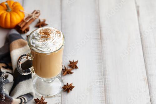 Fall pumpkin spice latte with whipped cream and cinnamon, ornamental pumpkins an Canvas Print
