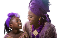 Mother And Child Girl Looking To Each Other.African Traditional Clothing .Isolated