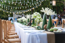 Beautiful Decoration Of Luxury Table Set Up By The Beach. Concept For Romantic Wedding Dinner Party Background.