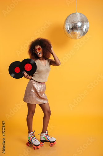 Full length portrait of a excited afro american woman - 177078997
