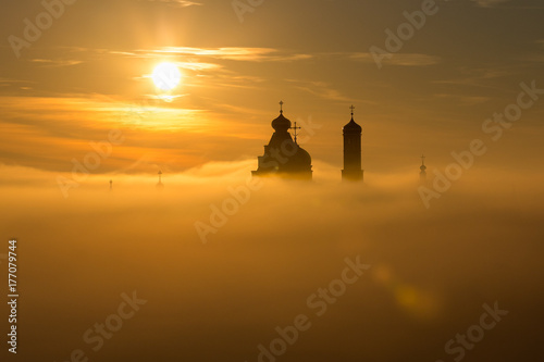Canvas Prints Ship Landscape: Church silhouette floating in the clouds at dawn.