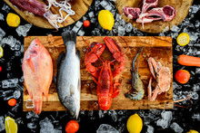 BBQ Ingredient; Fish, Squid, Lobster, Shrimp, Vegetable And Ice On Black Background