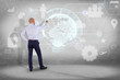 Businessman in front of a wall with an International business network connection displayed on a futuristic interface with technology icon and sphere globe - Worldwide business concept