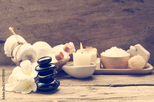 Foto op Canvas Zen Spa wellness concept,white candle,milk soap,salt,towel,flowers and herbal massage ball on rustic wood table background