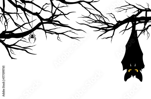 Photo halloween theme evil bat hanging among tree branches - monster vector design