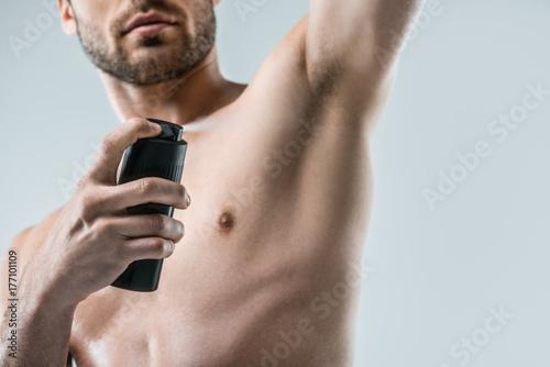 shirtless man spraying deodorant Wallpaper Mural