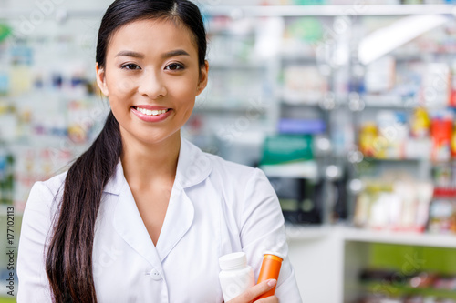 pharmacist with medication in drugstore Wallpaper Mural