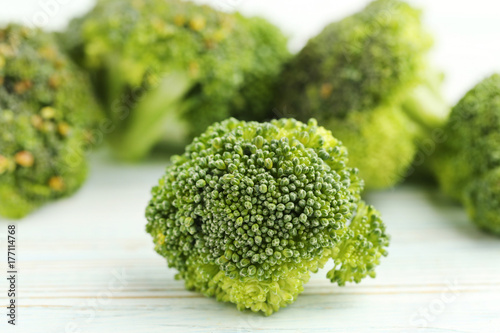 Broccoli on white wooden table