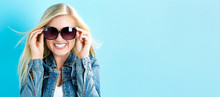 Young Woman With Sunglasses On...