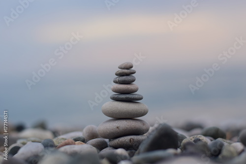 Photo Stands Zen a pyramid of stones by the sea