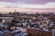 Lower Manhattan skyline over Brooklyn apartment rooftops