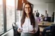 canvas print picture - Portrait of beautiful businesswoman holding digital tablet