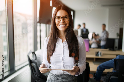 Portrait of beautiful businesswoman holding digital tablet Canvas Print