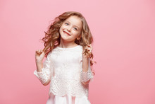 The Beautiful Little Girl In Dress Standing And Posing Over White Background
