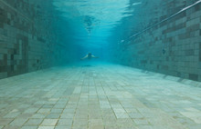 Man Diving Underwater Of A Swi...