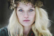 Portrait Of A Beautiful Woman With Freckles And Blue Eyes