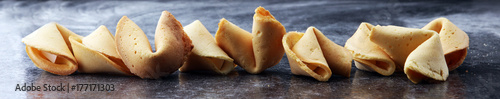 Photographie  Fortune Cookies on dark background. Chinese cookie with wisdom.