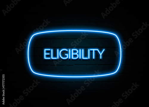 Photo  Eligibility  - colorful Neon Sign on brickwall