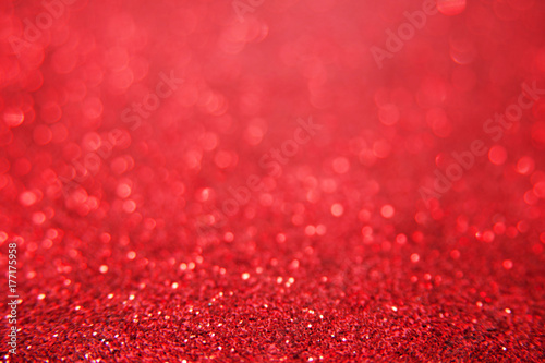 red bright glitter bokeh background sparkle texture for birthday card or christmas new year