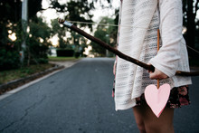 Girl Holding A Bow And Heart Shaped Arrow