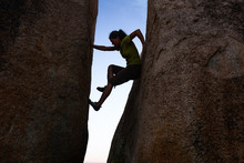 Woman Silhouette Climbing Betw...